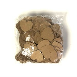 Large bag full of small heart-shaped tags packing